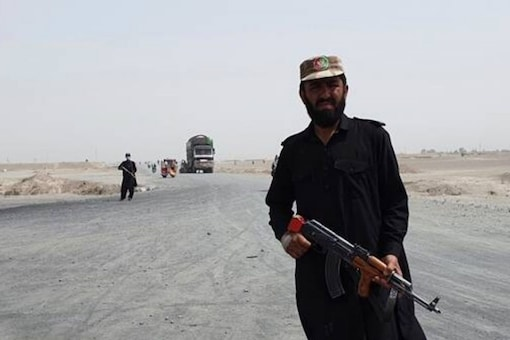 Pakistani paramilitary soldiers stand guard near the Pakistan Afghan border crossing following fighting between Afghan security forces and Taliban in SpinBoldak border area, in Chaman, Pakistan, Friday, July 16, 2021. (AP)