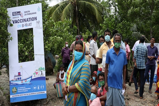 """Locals wait to receive their Covid-19 vaccine shot during a """"vaccination on boat"""" programme in Gosaba Island in West Bengal in this recent photo. (Reuters)"""