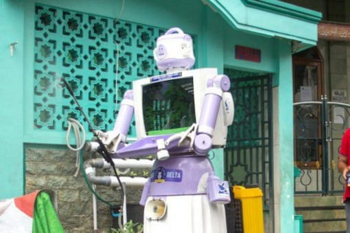 The robot's head is made from a rice cooker, and it is operated by remote control with a 12-hour battery life- Reuters