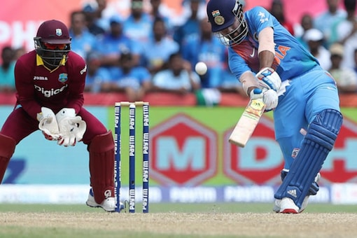 KL Rahul of India hits over the top for six during the only international T20 Trophy match between India and the West Indies in USA.