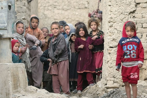 Internally displaced Afghan children looking on next to their shelters on the outskirts of Kabul, Afghanistan February 3, 2021. (Reuters/Omar Sobhani)