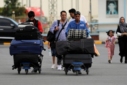 Thousands of panicked people fled to the airport in a bid to get on departing Western flights, after the Taliban seized control of the country. (File photo/AP)