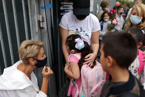 Children line up on the first day of school and return to full-time in-person learning after the coronavirus disease (COVID-19) break, in Glendale, Los Angeles, California, U.S., August 18, 2021. REUTERS/Lucy Nicholson