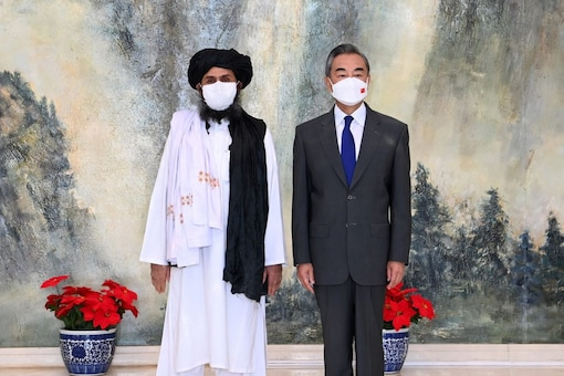 """Taliban leader Abdul Ghani Baradar (left) with Chinese Foreign Minister Wang Yi during a visit by a Taliban delegation to China in July. The Taliban have called China their """"most important partner"""". (File photo: Li Ran/Xinhua via REUTERS)"""