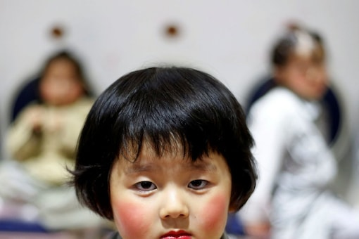 China formally wrote into law a policy allowing women to have three children, although it's unclear when that will take effect. (Reuters)