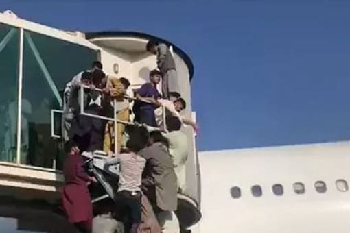 Desperate Afghans try to flee the country after Taliban takeover. (Twitter)
