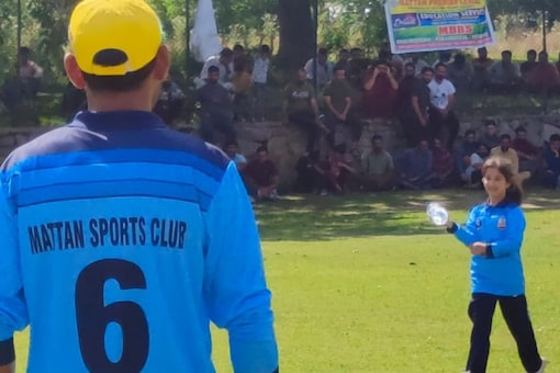 The young girl was sporting the t-shirt of her father's team, Mattan Sports Club, and looked happy while assisting her father on the ground.
