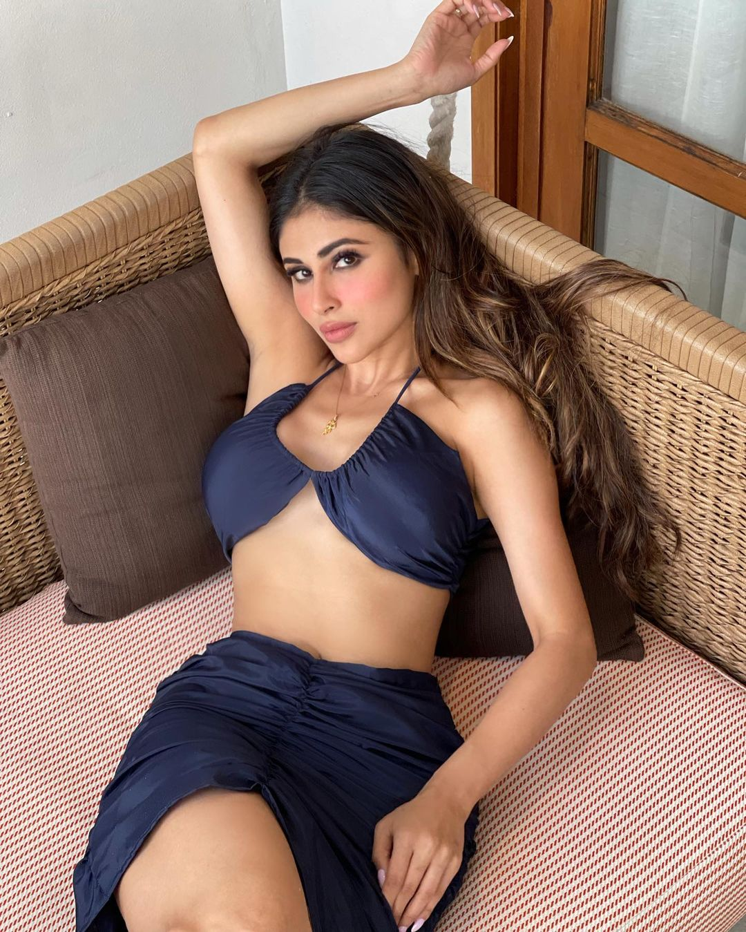 Mouni Roy is looking sensational in the black bikini top and matching skirt.