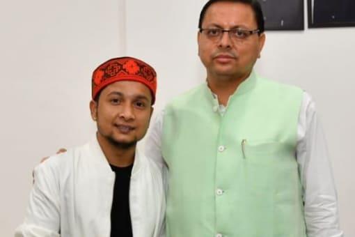 Uttarakhand CM Pushkar Singh Dhami with Indian Idol 12 winner Pawandeep Rajan.
