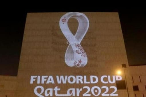 The tournament's official logo for the 2022 Qatar World Cup is seen on a building at Souq Waqif in Doha, (Reuters)