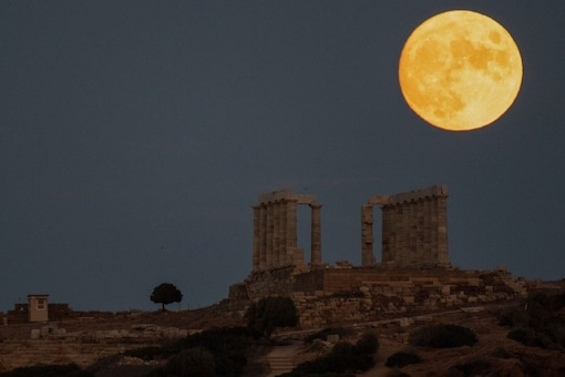 The sturgeon full moon rises behind the ancient Greek marble temple of Poseidon at Cape Sounion, Greece. (Image Credit:AP)