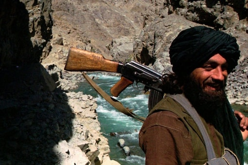 FILE - In this Oct. 8, 1996 file photo, a Taliban soldier patrols the entrance to the Panjshir Valley, north of Kabul. (Associated Press)