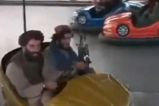 The videos show Taliban fighters on amusement park rides. (Credits: Twitter/@HamidShalizi)