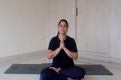 Sit on a yoga mat with your waist and neck straight and focus on yourself