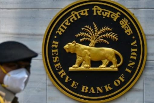 A security personal walks past an entrance of the Reserve Bank of India (RBI) headquarters in Mumbai on May 5, 2021. (Representational image from AFP)