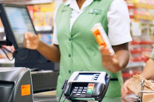 Representative image of a cashier, via Canva.