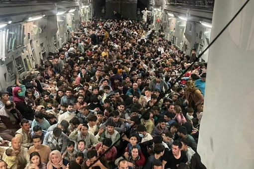 A photos of the a Air Force's C-17 Globemaster III shows hundreds of Afghans sitting on the floor of the aircraft.
