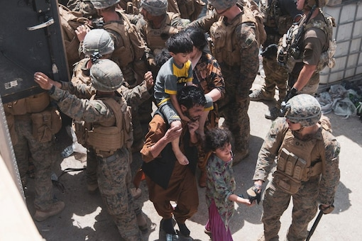 US Marines and Norwegian coalition forces assist with security at an Evacuation Control Checkpoint at Hamid Karzai International Airport, Kabul, Afghanistan, on August 20. (Reuters)