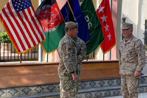 US General Austin Miller, (L) and US General Kenneth McKenzie,(R), at a ceremony in Kabul, as Miller relinquishes command during the final phase of America's withdrawal from the war in Afghanistan July 12, 2021. REUTERS
