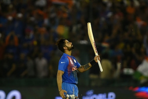 Virat Kohli celebrates after India's win over Australia in Mohali during T20 World Cup.