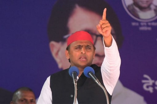 Akhilesh Yadav has advised the BJP to change its political symbol to a 'bulldozer', the BJP returned the fire by asking SP to take 'AK-47' as its poll symbol.  (AFP)