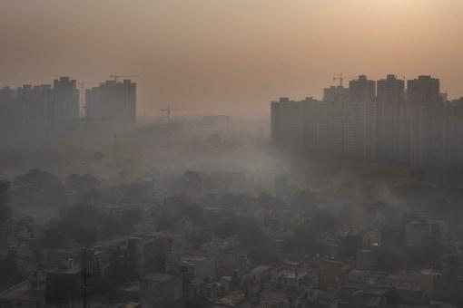 Morning haze envelops the skyline on the outskirts of New Delhi. (AP Photo/Altaf Qadri, File)