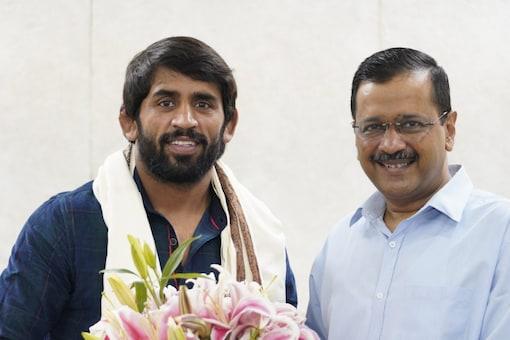 Arvind Kejriwal with Bajrang Punia. (Kejriwal Twitter Photo)