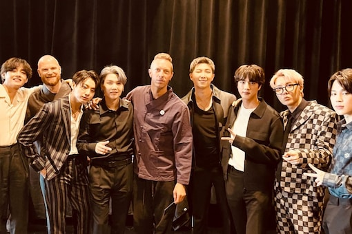 BTS and Coldplay pose for a picture