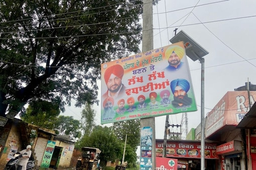 Posters and hoardings of Channi along with Navjot Singh Sidhu have come up all over Kharar and en route to Makrona Kalan. (News18)