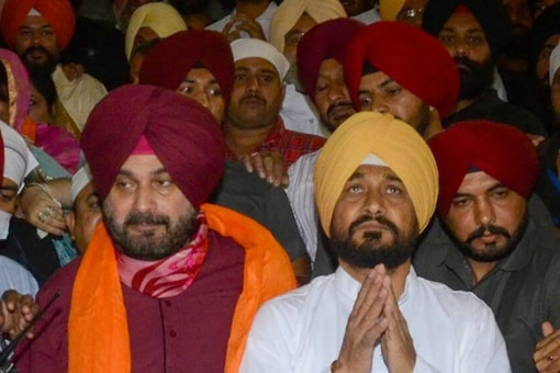 Punjab Chief Minister Charanjit Singh Channi and state Congress chief Navjot Singh Sidhu offer prayers at the Golden Temple in Amritsar, on September 22, 2021. (PTI Photo)