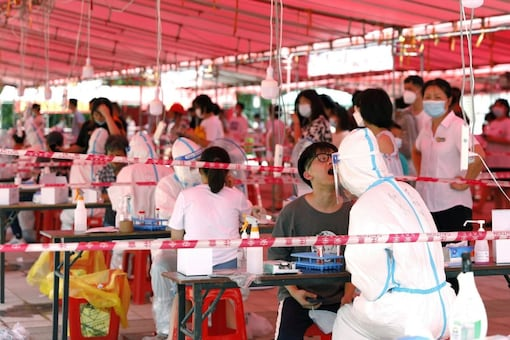 Medical workers conduct nucleic acid tests for residents in China. (Reuters)