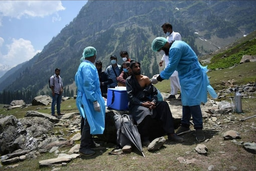 A healthcare worker administers a dose of Covishield to a shepherd near Pahalgam in south Kashmir's Anantnag district. (Reuters File)
