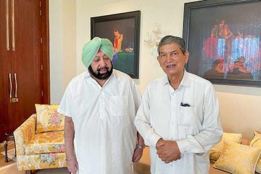 Harish Rawat (right) with Capt Amarinder Singh. (PTI File)