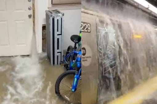 In a video from Brooklyn, a train is being showered upon by a torrent of water. (Image Credits: Twitter/@trbrtc)