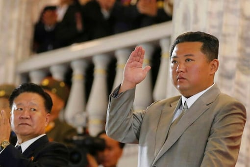 """In this photo provided by the North Korean government, North Korean leader Kim Jong Un, center, waves from a balcony toward the assembled troops and spectators during a celebration of the nation's 73rd anniversary at Kim Il Sung Square in Pyongyang, North Korea, early Thursday, Sept. 9, 2021. Korean language watermark on image as provided by source reads: """"KCNA"""" which is the abbreviation for Korean Central News Agency. (Korean Central News Agency/Korea News Service via AP)"""