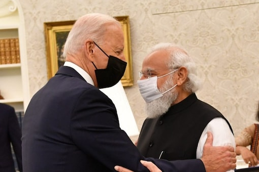 Prime Minister Narendra Modi hugs US President Joe Biden during a bilateral meeting in the Oval Office at Washington DC on Friday. (Image: @PMO India/Twitter)