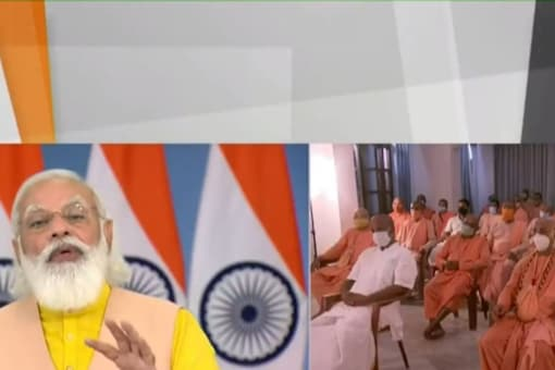 PM Modi participated in an event marking the 125th birth anniversary of Swami Prabhupada. (Image: Screen grab/PIB)