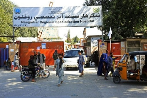 Afghan people are pictured outside the Nangarhar Regional Specialization Hospital after explosions in Jalalabad on September 18, 2021. (AFP)