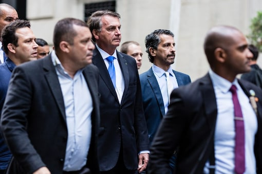Brazil's President Jair Bolsonaro walks outside his hotel while attending the UN General Assembly 76th session General Debate at the United Nations. (REUTERS/Stefan Jeremiah)