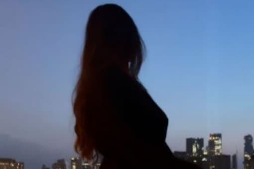 Suhana Khan shared a picture of herself while enjoying moon gazing at her apartment in New York.