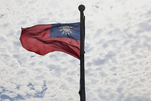 A Taiwanese flag flaps in the wind in Taoyuan, Taiwan, June 30, 2021. REUTERS/Ann Wang