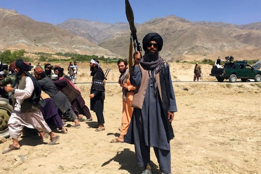 Taliban soldiers stand guard in Panjshir province northeastern of Afghanistan, Wednesday, Sept. 8, 2021. (AP Photo/Mohammad Asif Khan)