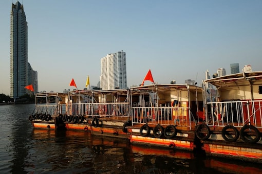 FILE PHOTO: Boats that are used to transport tourists around the Chao Phraya river are seen idle due to travel bans and border closures from the global coronavirus disease (COVID-19) outbreak in downtown Bangkok, Thailand February 4, 2021. Picture taken February 4, 2021. REUTERS/Jorge Silva