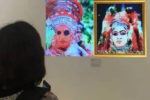 'Masked Reality' is an interactive installation where a viewer sees themselves as both a Theyyam and Kathakali dancer's face simultaneously. The work is rooted in deeply embedded dynamics of caste traditions associated with these two performances and uses AI to offer an alternative lens to revisit them, in an immersive setting.