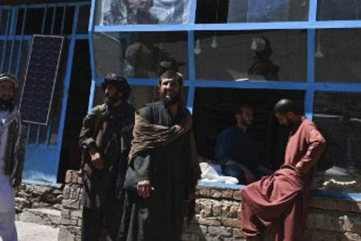 Taliban fighters stand in front of a bakery at a market area in Khenj district, Panjshir Province on September 15, 2021. (AFP)