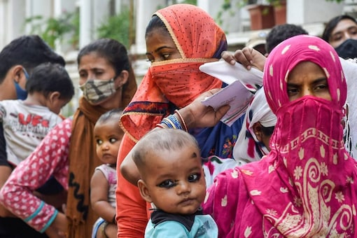 Beneficiaries wait to receive the Covid-19 vaccine dose at a free vaccination camp organised by the Delhi government, in New Delhi, on October 10, 2021. (PTI Photo/Atul Yadav)