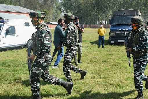 Security personnel arrive at Government Boys Higher Secondary School after militants shot dead two teachers, at Eidgah Sangam area of Srinagar, on October 7, 2021. (PTI Photo/S Irfan)
