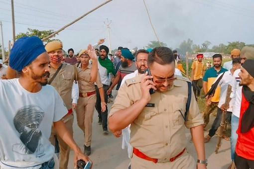 Lakhimpur Kheri: Farmers protest after some agitators were allegedly run over by a vehicle in the convoy of a union minister, in Lakhimpur Kheri. (PTI Photo)