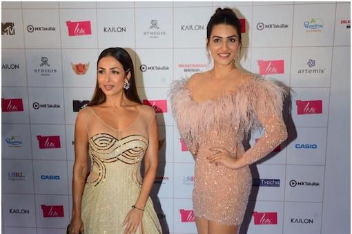 Malaika Arora and Kriti Sanon at the Miss Diva 2021 red carpet. Picture credit: Viral Bhayani.