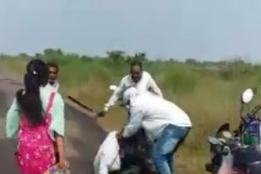 The video shows the stepfather and his friend pushing the youth to the ground and raining punches and blows on him. (News18)